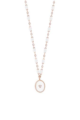Gigi Clozeau / Collier perles de résines et étoile du nord pendentif