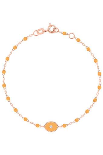 Gigi Clozeau / Bracelet or rose, perles de résine et médaille étoile du nord