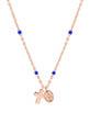 Gigi Clozeau / Collier or rose , perles de résine, croix et madone.